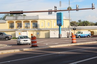 A car makes a right turn from Stickney Point Road onto Midnight Pass Road on Siesta Key. The barrels are related to a project entailing repairs to the Stickney Point Road drawbridge. Photo by Rachel Hackney