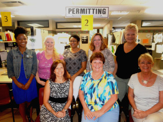 The City of Sarasota Building Division staff comprises (back row, from left) Brieana Duckett Graves, administrative specialist II – Permitting; Mary Beth Gripshover, administrative specialist II – permitting; Joyce Williams, permitting coordinator; Shelley Moore, Inspections Specialist; Paula Mello, Permits & Licenses Manager; (front row, from left) Robin Opalinsky, Administrative Specialist I - Permitting; Debbie Lapenkas, Administrative Specialist II -  Permitting; Kathleen Kelley, Administrative Specialist II - Permitting
