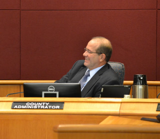 Harmer reacts after the board offers him the position of county administrator on a full-time basis. News Leader archive