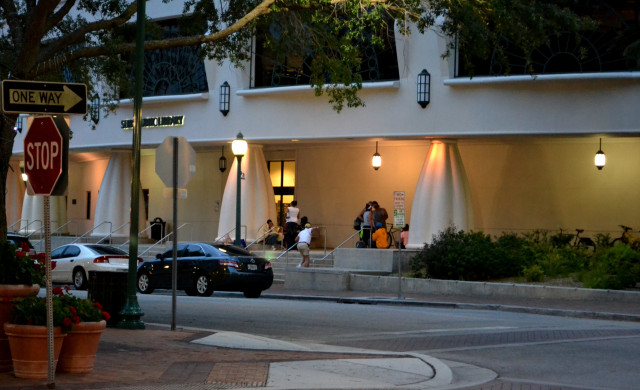 Homeless people gather outside Selby Library in downtown Sarasota. News Leader archive