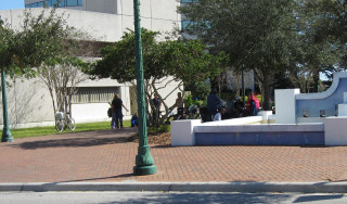 Homeless people gather in a downtown Sarasota park in early 2014. News Leader archive