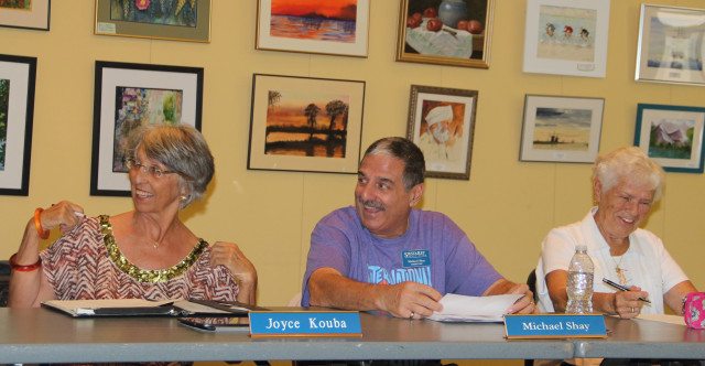 (From left) Siesta Key Association board members Joyce Kouba, Michael Shay and Helen Clifford enjoy a laugh before a recent meeting. File photo