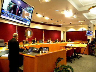 County Emergency Management Chief Ed McCrane (left) addresses the County Commission. News Leader archive
