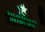 Sheriffs Office sign 2 at night Oct. 2015