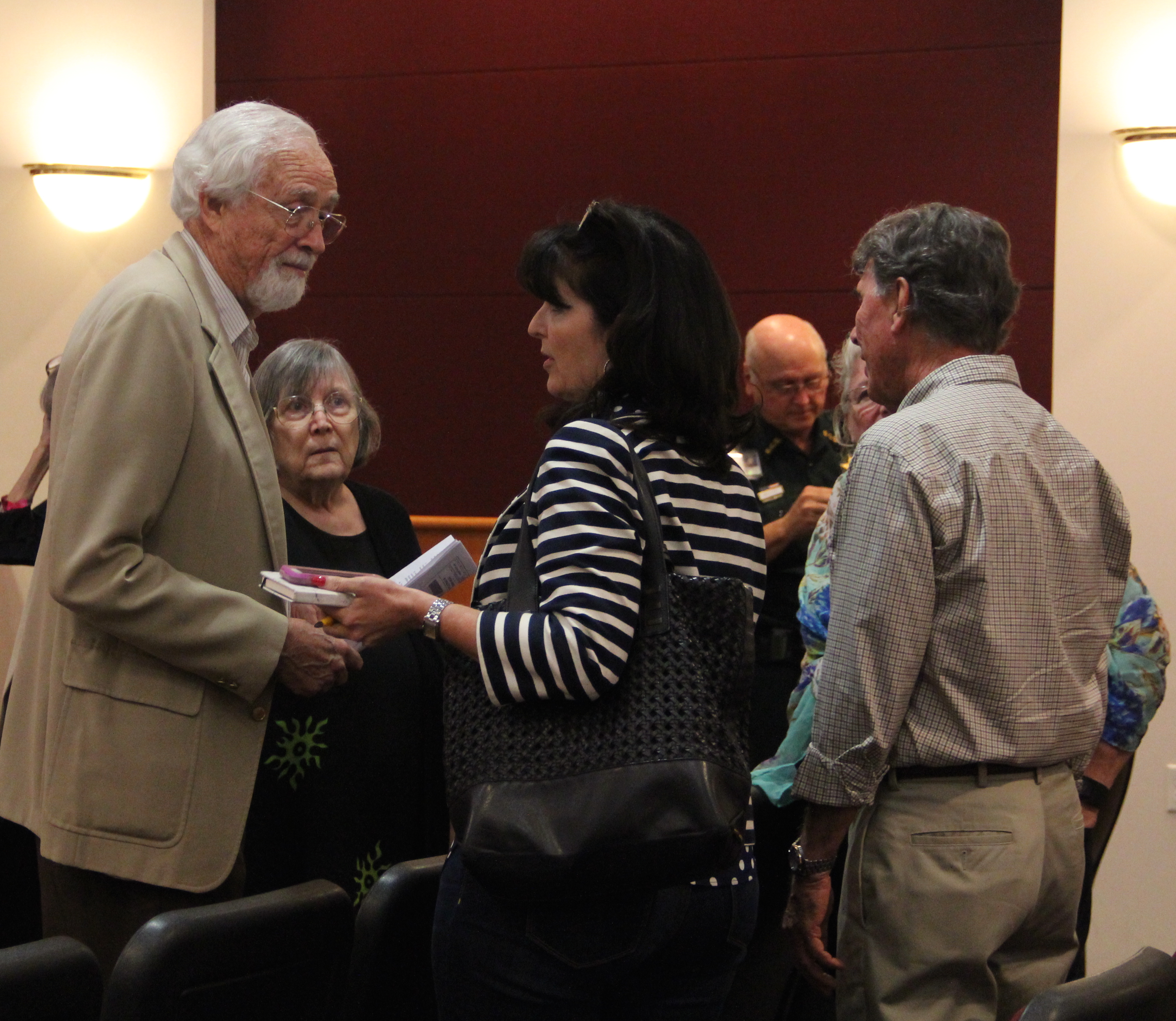(From left) Wade Matthews of Sarasota Audubon, Kafi Benz of the Sarasota County Council of Neighborhood Associations (CONA), Cathy Antunes of CONA and architect Bill Zoller confer during a break in the meeting. Rachel Hackney photo