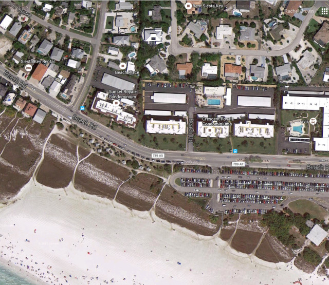 The Crescent Royale Condominiums are across Beach Road from Siesta Public Beach. Image from Google Maps