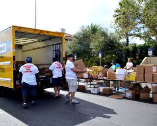 Volunteers sort food items for the Mayors Feed the Hungry Program in 2013. File photo