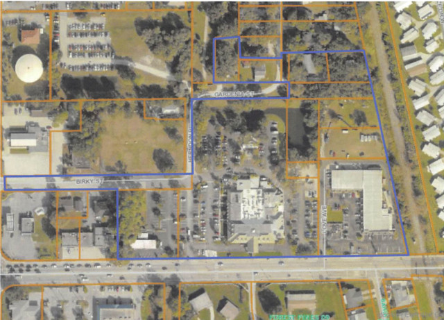 An aerial map shows the site of the proposed hotel (outlined in blue). Image courtesy Sarasota County