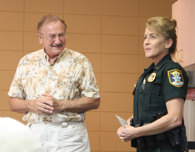 SKA board member Joe Volpe presents the check to Lt. Debra Kaspar. Rachel Hackney photo