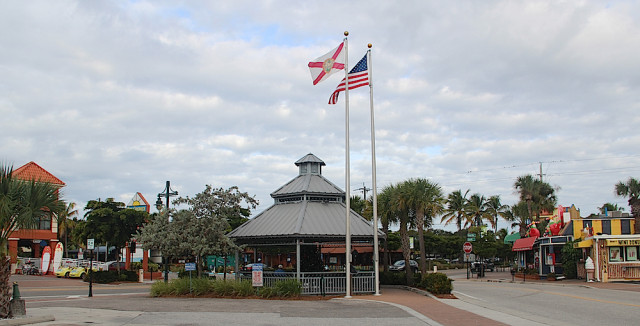 Flags fly over the gazebo in Siesta Village on a cloudy morning. Rachel Hackney photo