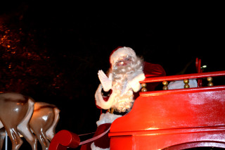 St. Nicholas waves from a float during the 2012 Holiday Parade. File photo