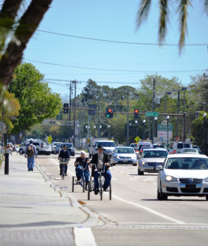 Amish bicyclists head down Bahia Vista Street. File photo