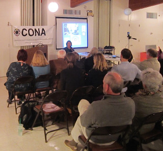 Members of CONA listen to a program earlier this year. File photo