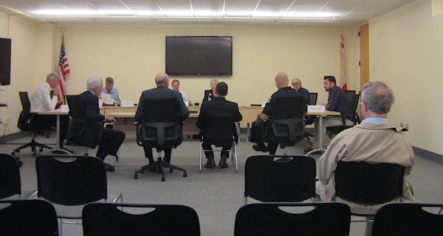 (From left in the foreground at the table) Doug Logan, director of special Iiitiatives on chronic homelessness, City Manager Tom Barwin, County Commissioner Paul Caragiulo and Capt. Kevin Stiff of the Sarasota Police Department answer questions during the Feb. 2 DID meeting. File photo