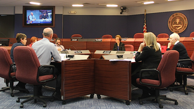School district Planning Director Kathie Ebaugh and Deputy Superintendent Scott Lempe talk with the School Board members on Feb. 16. Rachel Hackney photo