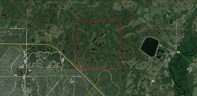 An aerial map shows Orange Hammock Ranch outlined in red. Image courtesy Sarasota County