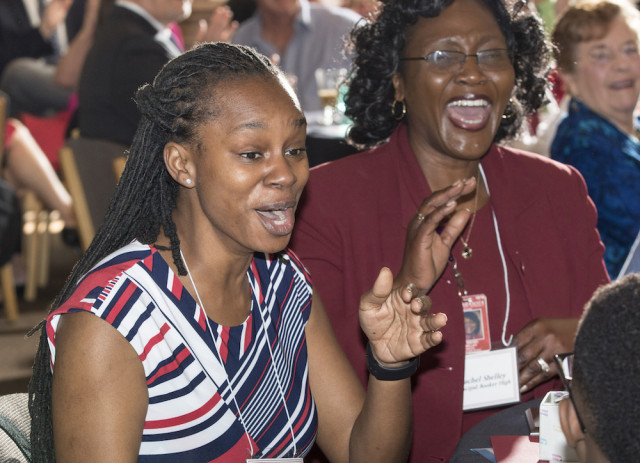 Booker High School language arts teacher Khea Davis (left) and Booker High Principal Rachel Shelley react to the news that Davis is the 2016-17 Sarasota County Teacher of the Year. Contributed photo by Rod Millington