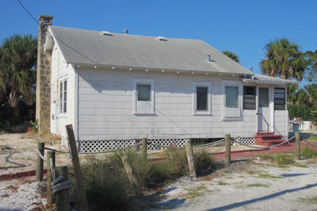 A cottage was on a parcel the county bought several years ago next to Beach Access 7. File photo