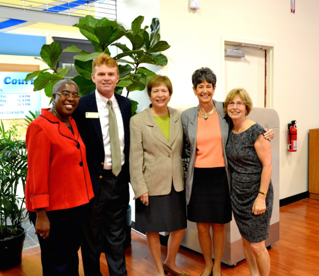 (From left) Commissioners Carolyn Mason and Charles Hines, then-Commissioner Nora Patterson, former Commissioner Shannon Staub and Conni Wheeler of the Friends of Gulf Gate Library mark the opening of temporary facilities in Sarasota Square Mall in February 2013. File photo