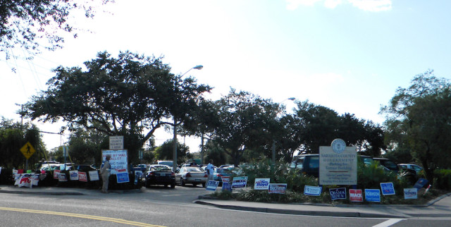 Signs abound at the Terrace Building in downtown Sarasota during early voting in October 2012. File photo