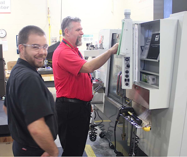 Ed Doherty (right) works with an unidentified student in the Precision Machining Program. Image courtesy Sarasota County