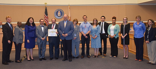 The five Sarasota County commissioners (from left) join county Health Official Chuck Henry (center) and representatives of county and the Sarasota County School District in celebrating the honor. Photo courtesy Sarasota County