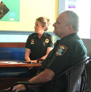 Lt. Debra Kaspar and Capt. Charlie Thorpe of the Sarasota County Sheriff's Office attend the Siesta Key Village Association's March 1 meeting. Rachel Hackney photo