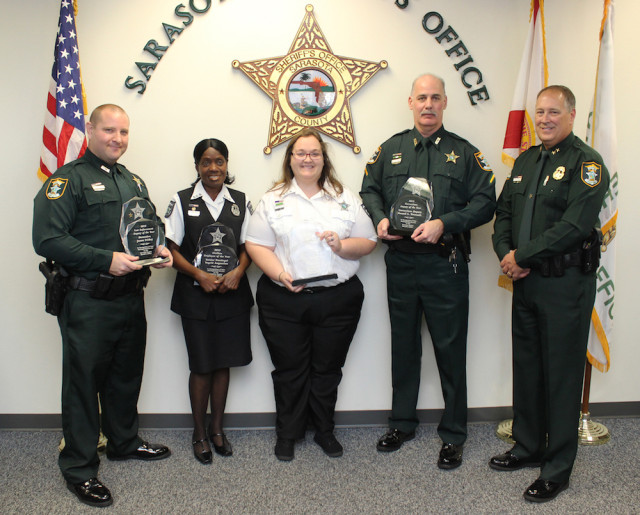 (From left) Deputy Jason Friday, Ingrid Augustine, Tia Brand, Deputy Russell Tetreault and Sheriff Tom Knight. Contributed photo
