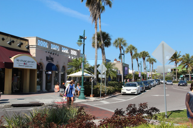 A shopper steps onto a St. Armands Circle crosswalk. File photo