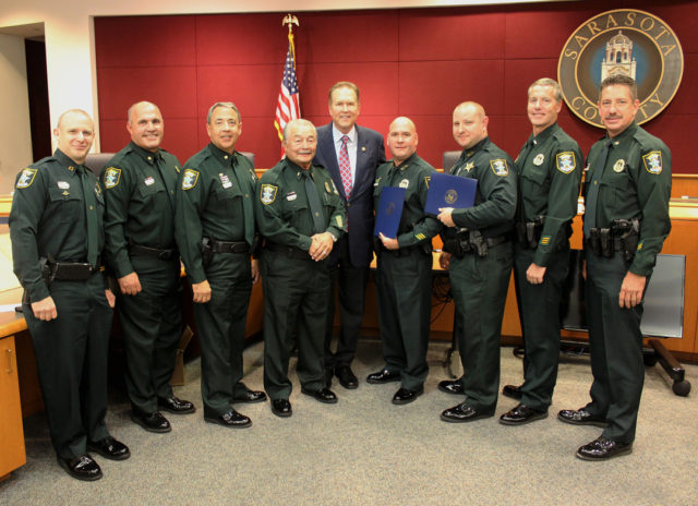 (From left) Capt. Brian Meinberg, Maj. Jeff Bell, Maj. Paul Richard, Lt. Johnny Yong, Congressman Vern Buchanan, Sgt. Donny Kennard, Det. Jason Friday, Lt. Dave Scott and Col. Kurt Hoffman. Contributed photo
