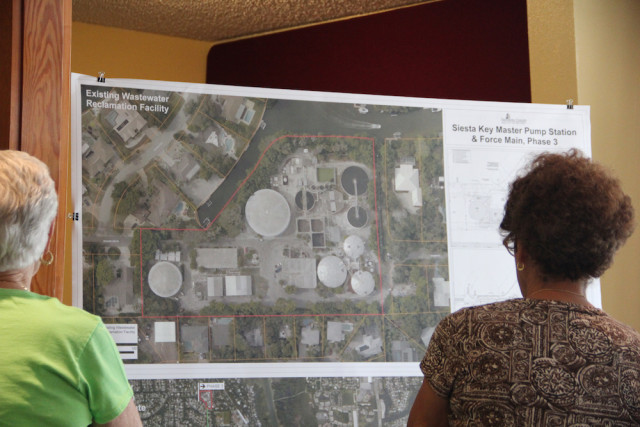 Siesta Key Association members look at an aerial map of the wastewater plant during their April 7 meeting. Rachel Hackney photo