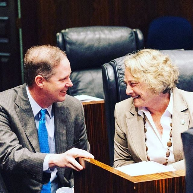 State Sens. Wilton Simpson and Nancy Detert share a laugh during the 2016 session. Several candidates are vying to take Detert's seat. Photo courtesy Florida Senate
