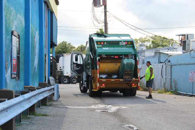 A Waste Management truck empties a garbage container at The Beach Club. Rachel Hackney photo