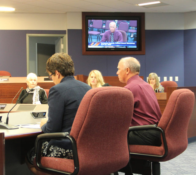 Planning Director Kathie Ebaugh (left, foreground) and Deputy Superintendent Scott Lempe address the School Board on April 19. Rachel Hackney photo