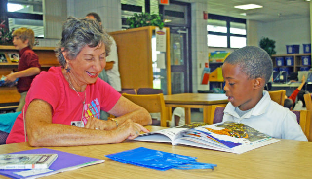 Volunteer Barbara Grauer tutors Kareem Smith, a Booker Elementary School student. Contributed photo