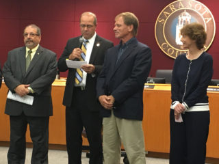 County Administrator Tom Harmer reads notes about Tatge's career during the presentation. Photo courtesy of Drew Winchester, Sarasota County