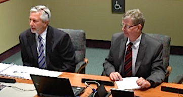 Mark Lyons (left) and Mike Connolly address the board. News Leader photo