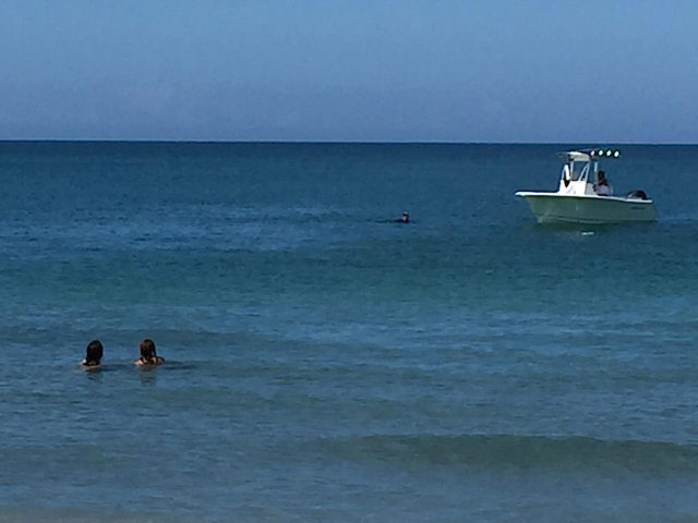 A boat and swimmers are offshore of Turtle Beach on Memorial Day weekend. Photo courtesy of Andrew Terry