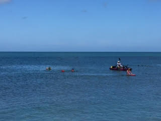 Another photo shows swimmers and watercraft. Photo courtesy Andrew Terry