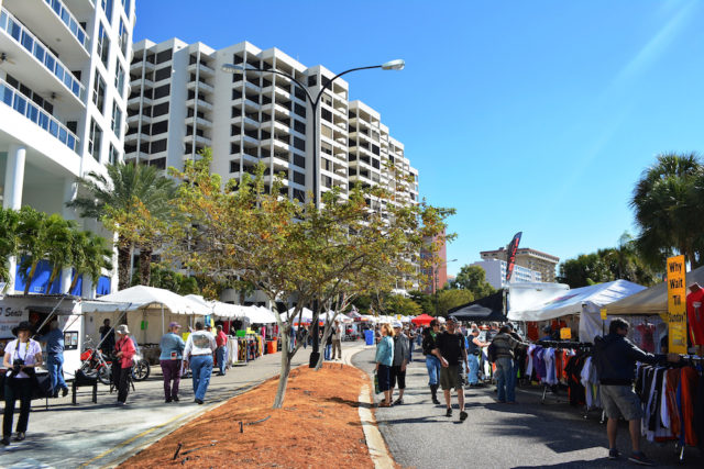 Participants in Thunder By the Bay visit vendors' booths on Gulfstream Avenue in 2014. File photo