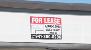 A 'For Lease' sign was prominent on the front of the building in March. Rachel Hackney photo