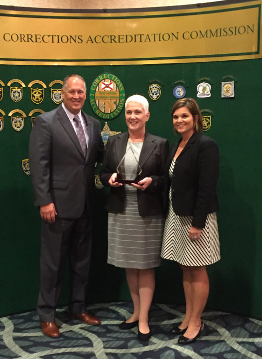 (From left) Sheriff Tom Knight, Accreditation Manager Sarah Kenniff and CFA Executive Director Lori Mizell. Contributed photo