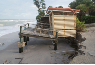This wooden deck was damaged at 2108 Casey Key Road. Image courtesy Sarasota County Environmental Protection Division