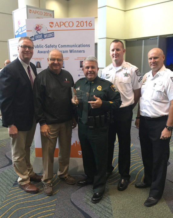 (From left) Sarasota County Director of Emergency Services Rich Collins, Public Safety Communications Manager Jerry Wheeler, Emergency Operations Bureau Captain Tim Enos, Technical Services Technician Dan Sullivan and Supervisor Brett Thomas accept the award. Contributed photo