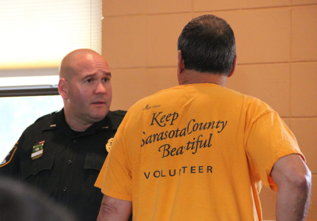 Lt. Donny Kennard (left) talks with Michael Shay before the start of the Aug. 4 SKA meeting. Rachel Hackney photo
