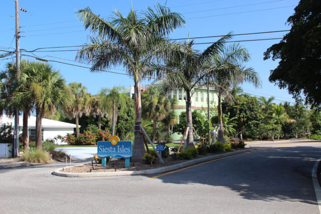 A Siesta Isles sign also greets drivers entering the neighborhood via Beach Way. Rachel Hackney photo