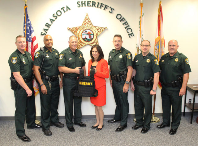 (From left) Lt. Ryan Brown, Deputy Todd Armistead, Sheriff Tom Knight, Clerk of the Circuit Court and County Comptroller Karen E. Rushing, Col. Kurt A. Hoffman, Lt. Brian Gregory and Major Jeff Bell gather in recognition of the collaboration between the offices. Contributed photo