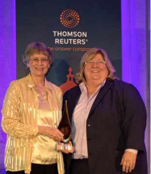 Sarasota County Tax Collector Barbara Ford-Coates (left) accepts the award from Lisa Hargiss, senior director for technical marketing with Thomson Reuters. Contributed photo