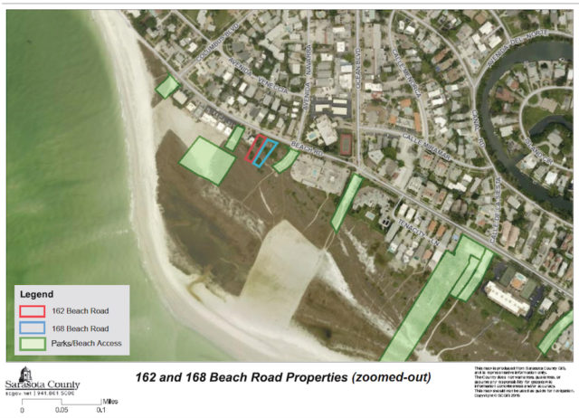A county aerial map shows the parcels outlined in red and blue, located near Siesta Village. Image courtesy Sarasota County