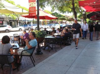 This photo of people dining outside downtown Sarasota restaurants was among those submitted with the City of Sarasota application. Image courtesy City of Sarasota